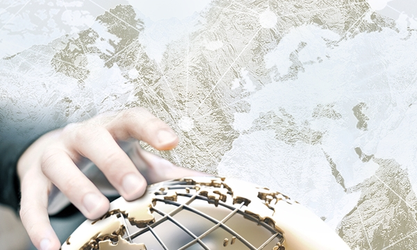 A collage with mountains, globe, and a hand